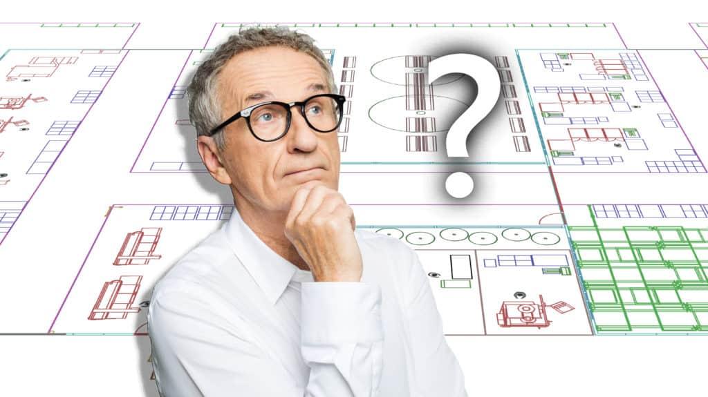 Produktionsleiter steht vor Entscheidung ob 2D oder 3D Fabriklayout