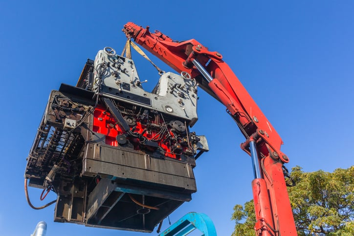 loading of heavy machinery by a crane