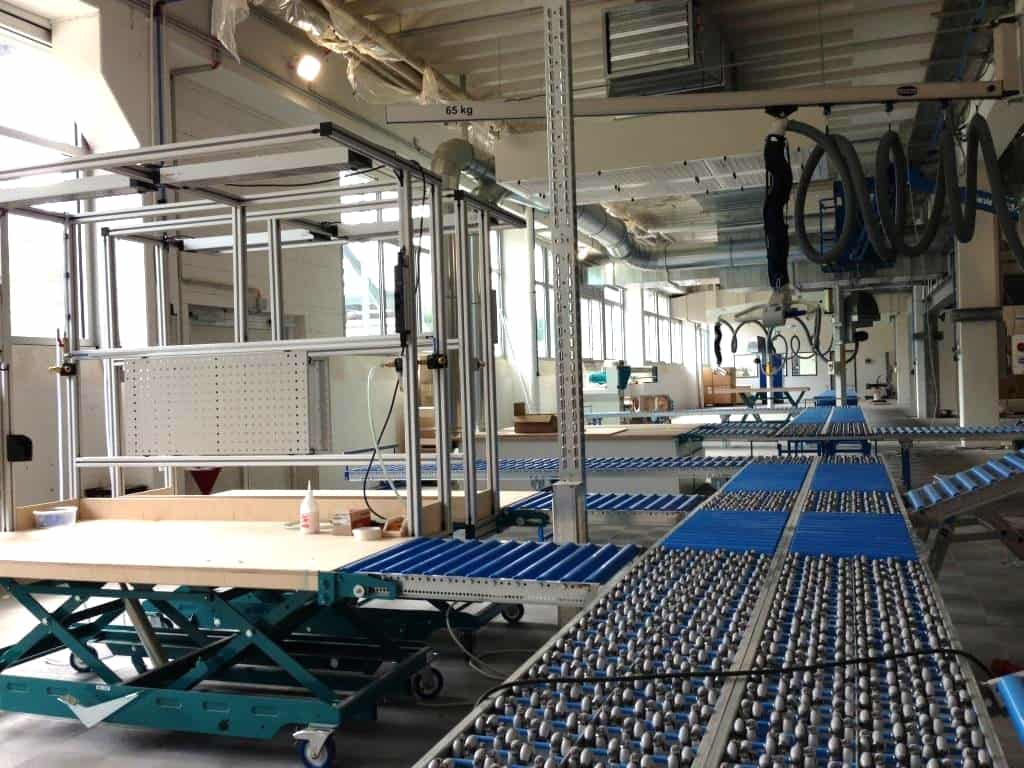 View into the production with roller conveyor system at d&b Audiotechnik